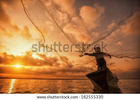 Fisherman of Bangpra Lake in action when fishing, Thailand - stock photo