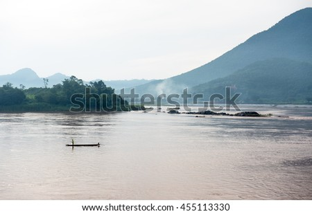 Fisherman on a boat.Mekong river.