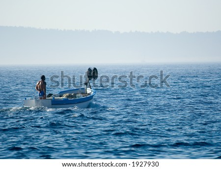 Fisherman on a small old boat