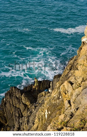 Fisherman on Cinque Terre - road of love, Liguria - stock photo