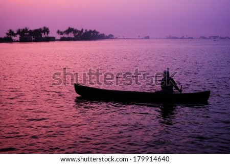 Fisherman on dusk, Backwaters, Kerala, India - stock photo