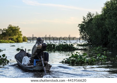 Fisherman on Mekong Delta in Early Morning