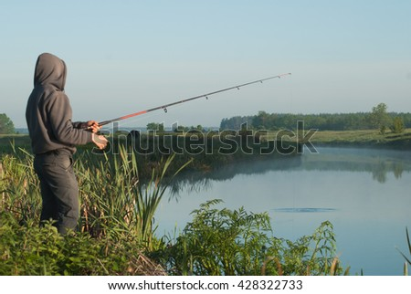 Fisherman on the river Bank, fishing with a fishing rod