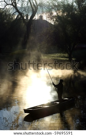 Fisherman on the river in the morning sunlight.
