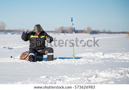 Fishing jig stock images royalty free images vectors for Winter fishing gear