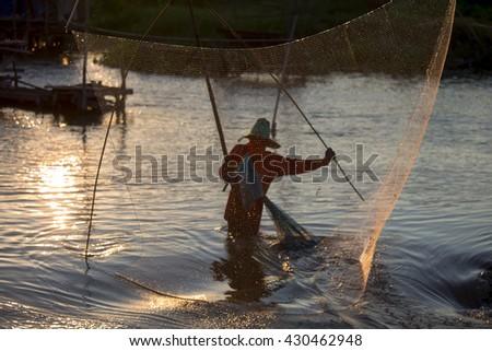 Fisherman's life at the lake sunset - stock photo