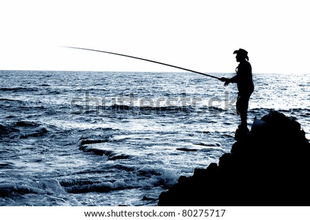 fisherman silhouette - stock photo
