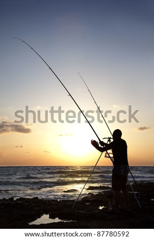 Fisherman silhouette fishing during sunset. Mediterranean Sea, Cyprus