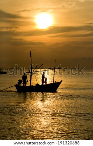 Fisherman silhouette in sea at sunrise , Thailand - stock photo