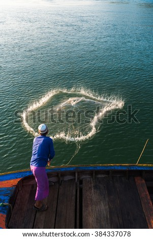 Fisherman throwing Fishing Nets - stock photo