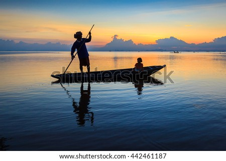 Fisherman with boat in action ,Thailand