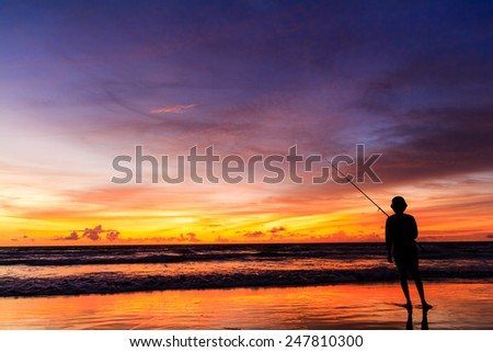 Fisherman with sunset, Bali, Indonesia