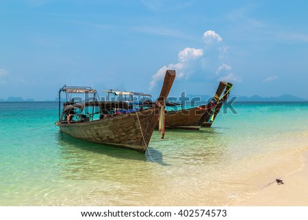 Fisherman wooden boat on sea coast with turquoise water