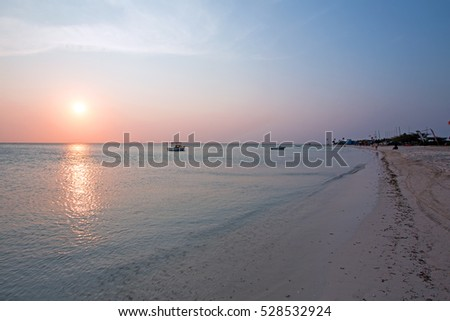 Fishermans Huts on Aruba island in the Caribbean Sea at sunset