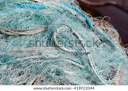 Fishermans net in blue or turquise colors. Great for background. - stock photo