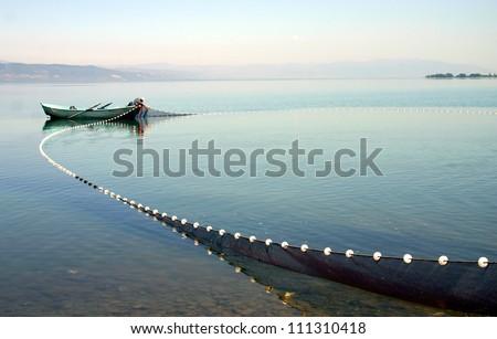 Fishermen at Lake near Iznik Turkey - stock photo