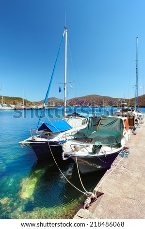 Fishermen boats at Kalamitsi harbor in Sithonia, Northern Greece  - stock photo