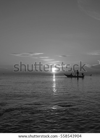 Fishermen fishing in the sea of black and white images