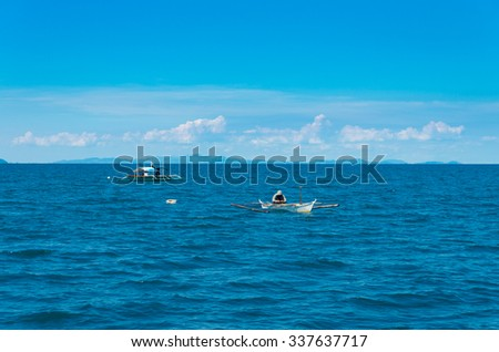 fishermen in small boats in the philippines