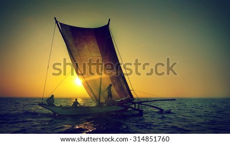 Fishermen on a catamaran at Sunset Concept