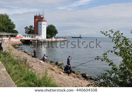 fishermen on the coast of the Baltic Sea