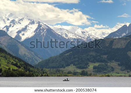 Fishermen on the Zeller See with beautiful mountains in the background