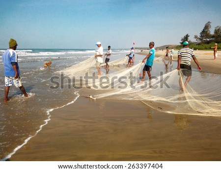 Fishermen pull fishing nets from the sea. 18.01.2014 North GOA, India - stock photo