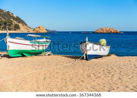 Fishermen's boat on a beach, Tossa de Mar, Costa Brava, Catalonia - stock photo