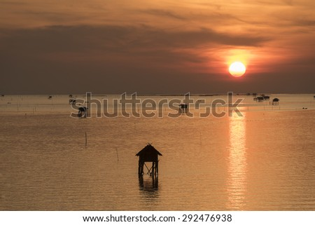 Fishermen's cottages Cabin In The Sea sunset for fishing in the ocean, Thailand - stock photo
