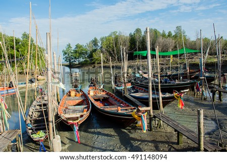 Fishermen village with long tail boat port at Suratthani, Thailand.