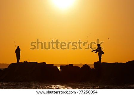 fishermens at sunset - stock photo