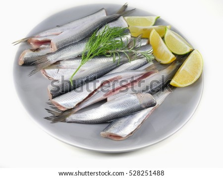 fishes herrings with lemon on a plate