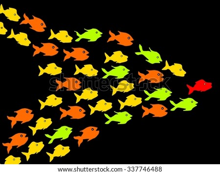 Fishes in dark background, leadership concept - stock photo