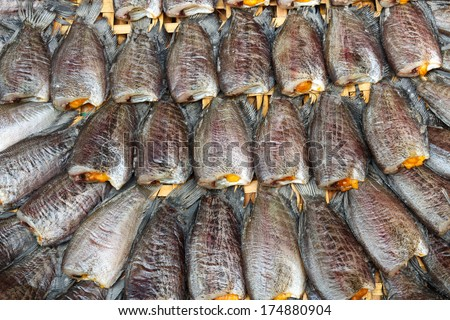 Fishes (Trichogaster pectoralis) arrange on rattan in market - stock photo