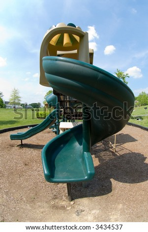 Fisheye lens used to capture curly slide on a playground, giving a slightly bulging, 3-D effect.