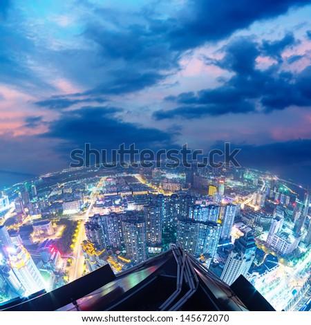 Fisheye Lens view of City skyline at night - stock photo