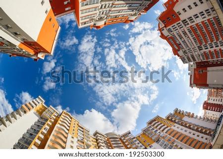 Fisheye shot of new apartments buildings exterior - stock photo