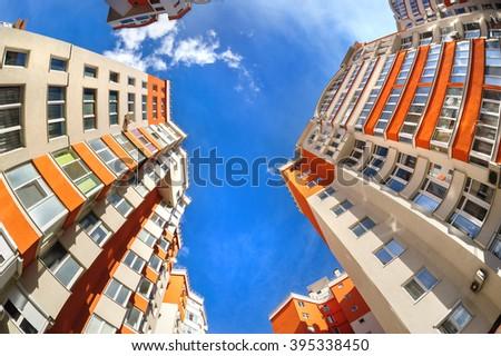 fisheye shot of new residential buildings - stock photo
