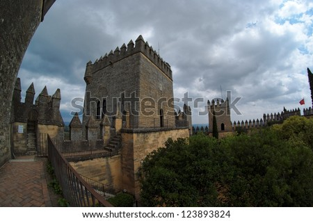 Fisheye view of Almodovar del Rio medieval castle on a cloudy day - stock photo