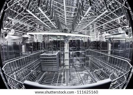 Fisheye view of the interior of an empty dishwasher - stock photo