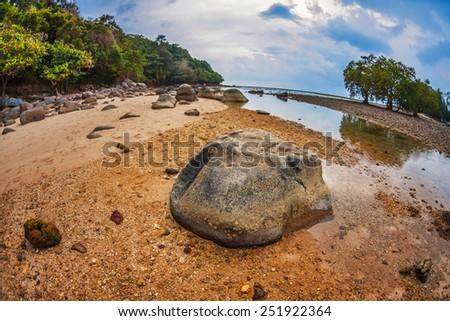 fisheye view on beach with gloomy sky - stock photo