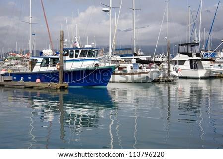 Fishing and pleasure boats in harbor in Seward, Alaska - stock photo