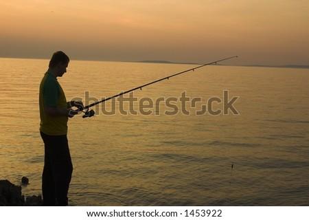 fishing at sunset - stock photo