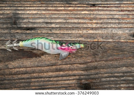 Fishing bait isolated on wooden background