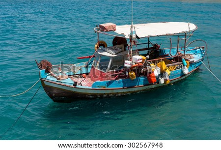 Fishing boat anchored in Matala bay, Crete, Greece - stock photo