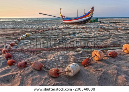 Fishing boat and net, Portugal - stock photo