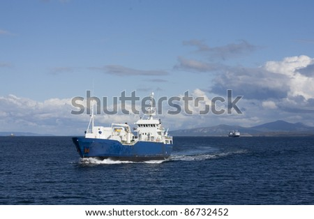 Fishing boat and passenger boat at the Norwegian coast - stock photo