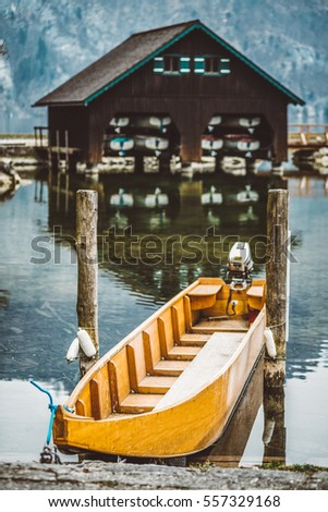 Fishing boat and wooden house on shore of Traunsee Lake in Traunkirchen, Austria
