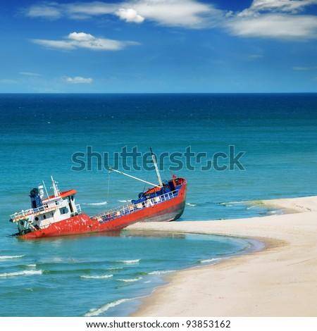 Fishing boat beached - stock photo