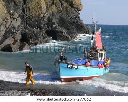 Fishing Boat Beached Cornwall UK - stock photo